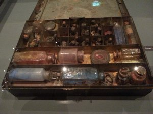 Turner's paintbox - pigs bladders for carrying mixed pigments at the top of the box and jars of ground pigment at the front