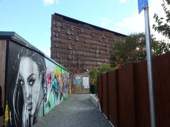East facade of the Nishi Building along with some of the graffiti art on the building site hoardings