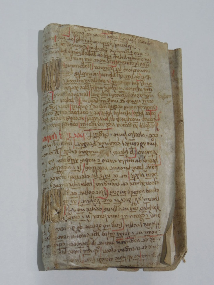 Manuscript re-used as a part of a book binding.